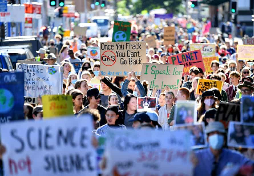 Climate strike protesters marching towards Queensland's parliament building in Brisbane.