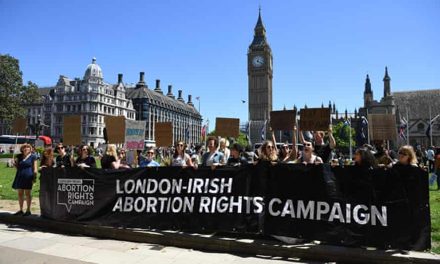 Campaigners for abortion rights in Northern Ireland protest in front of the Houses of Parliament in London.