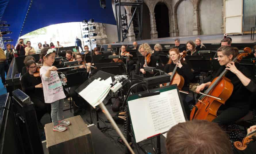 A girl conducts the City of London Sinfonia as part of Opera Holland Park's open day.