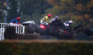 Runners take a fence in fading light at Sandown last month.