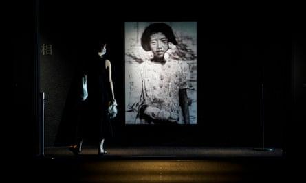 visitor looks at photographs of the Hiroshima bombing survivors, at the Hiroshima Peace Memorial museum.