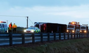 A loory overturned in high winds on the M74 near Kirkmuirhill, South Lanarkshire