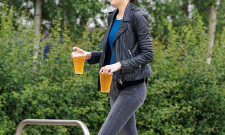 Young woman carrying beers
