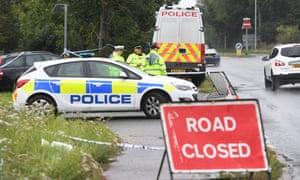 Police cordon off the murder scene.