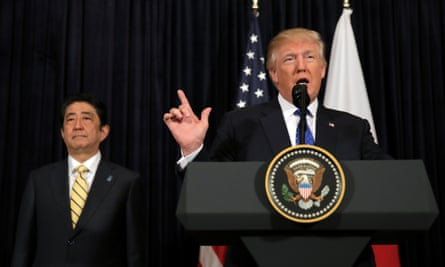 Donald Trump delivers remarks on North Korea accompanied by the Japanese prime minister, Shinzo Abe.