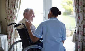 Nurse talking to older man in home