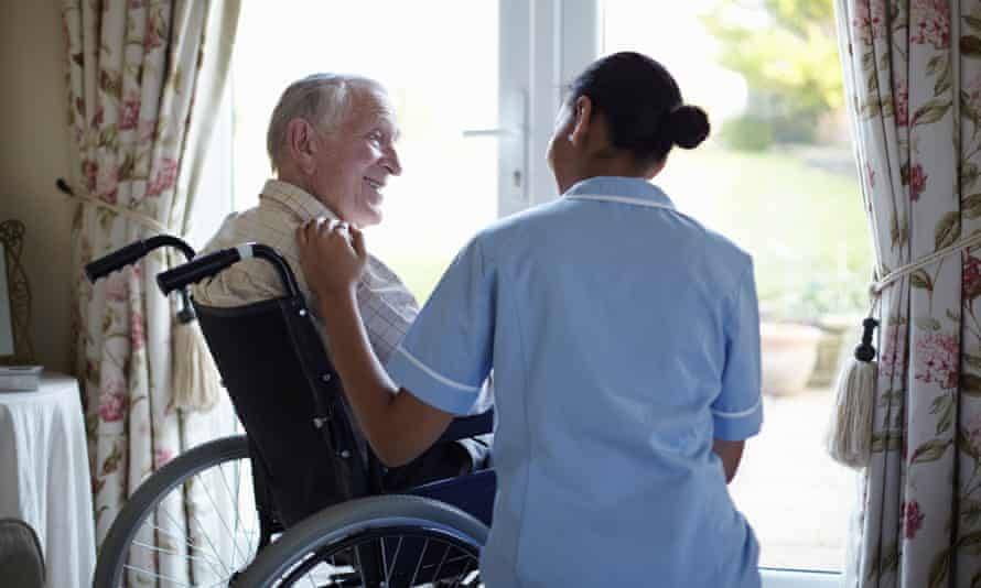 Young carer talking to older man in home