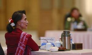 Myanmar pro-democracy leader Aung San Suu Kyi takes part in talks with Myanmar's military leaders in April 2015.