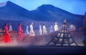 Models parade creations from the Heaven Gaia collection by Xiong Ying during China Fashion Week in Beijing