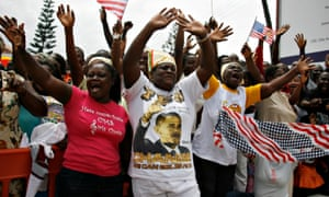 Ghanaians cheer and wave as a convoy carrying Barack Obama passes by during his first visit to sub-Saharan Africa in Accra on 11 July 2009.