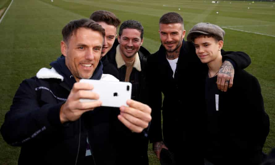 Phil Neville (left) takes a photo with his son Harvey, sports agent Dave Gardner, and David and Romeo Beckham at Salford City's ground in 2019.