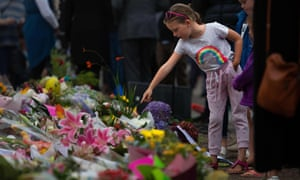 People pay their respects at a memorial site in Christchurch
