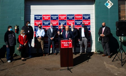 Rudy Giuliani addresses the media round the back of a gardening shop, Pennsylvania.
