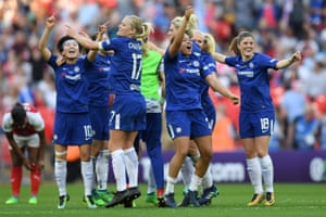 The Chelsea players celebrate after the final whistle.