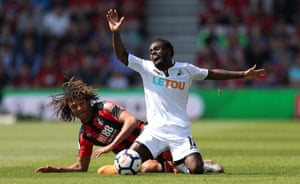 Nathan Dyer of Swansea City is challenged by Bournemouth's Nathan Ake as The Cherries win 1-0 at the Vitality Stadium.