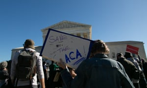 A group of protestors gathers outside of the supreme court Tuesday in Washington DC.