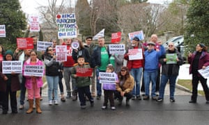 Protesters with the 'Lifestyles of Rich & Shameless' bus tour outside billionaire Steven Cohen's mansion in Greenwich, Connecticut.