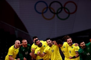 Team Brazil pump themselves up after singing the national anthem before their handball match against Norway