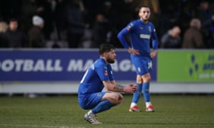 AFC Wimbledon's Anthony Wordsworth looks dejected after the final whistle.