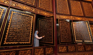A visitor looks at pages of the Qur'an at the Bayt al-Qur'an al-Akbar Museum