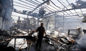 An employee stands in the bomb-damaged factory in the capital's Nahda district