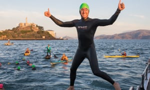 Graham Little tries the water off Alcatraz, San Francisco