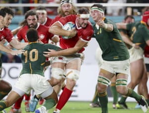 Canada's Tyler Ardron runs at South Africa's Elton Jantjies, left.