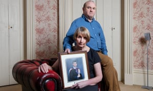 Ray and Alison Johnson with a photo of their son Elliott, who was found dead earlier this year