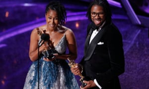 Karen Rupert Toliver and Matthew A Cherry pick up the Oscar for best animated short film for Hair Love.