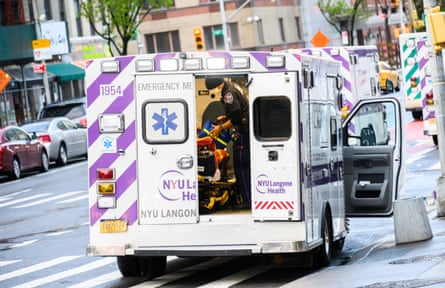 EMS worker is seen outside NYU Langone Health hospital in New York City.