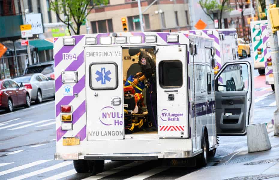 EMS worker is seen outside NYU Langone Health hospital in New York City.