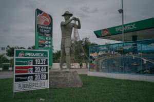 A monument to the fishermen stands in the front of a gasoline station from Pemex, the Mexican state-owned petroleum company, in Tuxpan, Veracruz. Due to a decline of fish in the last years, many locals have migrated to work in maquilas in the Northern states.
