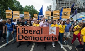 Liberal Democrat supporters led by the party's MP Ed Davey march in London against Brexit