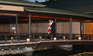 Theresa May and the Japanese prime minister Shinzo Abe walk to a Japan-Britain dinner at the Kyoto State Guest House in Kyoto.