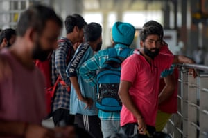 Indian nationals arrive at the New Delhi airport in October after being deported from Mexico as they tried to enter the US.