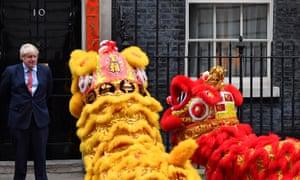 Boris Johnson faces Chinese New Year dragons outside No 10.