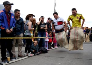 Competitors take part in a sack race in Bogotá, Colombia
