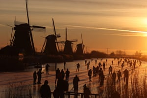 Kinderdijk, NetherlandsSkaters glide on the ice near windmills in the village. Skaters are called upon to skate as much as possible in their own neighbourhood, to prevent crowds and thus the spread of Covid-19