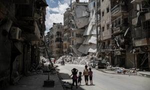 Children walk toward a building in Aleppo, Syria, in 2014.