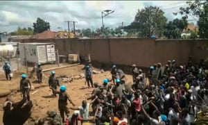 A screengrab from video footage showing crowds as they confront UN peacekeepers on the outskirts of Beni on 25 November.
