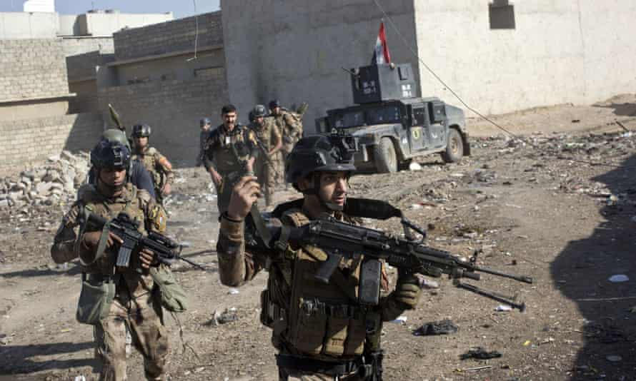 Iraqi special forces soldiers in an alley on the outskirts of Mosul as part of the operation to retake the Islamic State stronghold.
