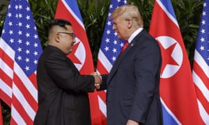 President Donald Trump, right, shakes hands with North Korean leader Kim Jong Un at the Capella resort on Sentosa Island in Singapore.