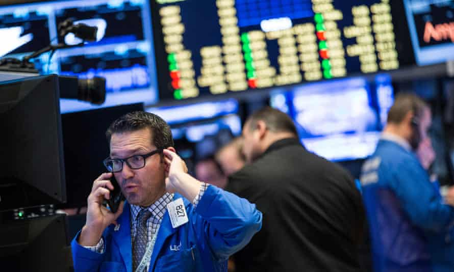 A trader works on the floor of the New York stock exchange during a record-breaking bad start to the year.