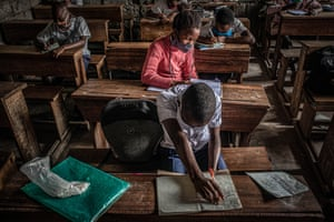 Students attend class as schools reopened in the eastern city of Goma in August