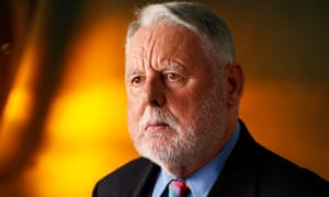 Terry Waite looking stern in a suit.