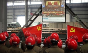Workers in Zhijiang watch a live broadcast of the Communist party congress as Xi Jinping prepares to take power, November 2012
