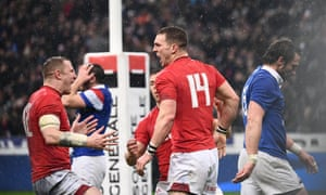 George North celebrates with his Wales teammates after scoring his second and decisive try to complete a remarkable turnaround against France.