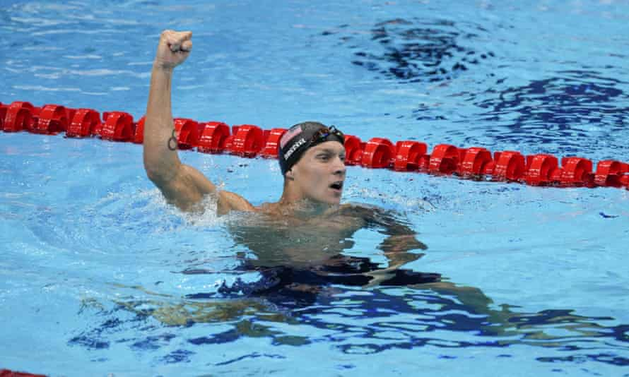 Caeleb Dressel celebrates after winning the gold medal in the men's 50m freestyle.