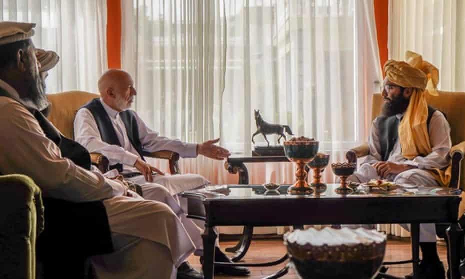 A Taliban photograph shows Hamid Karzai, centre left, talking to Anas Haqqani, right, leader of the Haqqani Network of the Taliban.