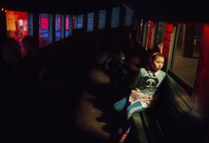 A local sits on board the steam train